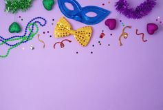 Carnival or mardi gras background with carnival masks, beards and photo booth props stock photos