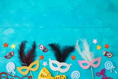 Carnival or mardi gras background with carnival masks and photo booth props stock photo