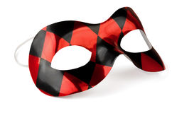 Carnival mask. Red and black carnival mask isolated on white royalty free stock image