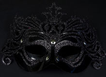 Carnival mask. Black carnival mask on a black background Stock Image