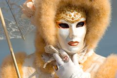Carnival mask. Venetian carnival costume with an umbrella Royalty Free Stock Photos