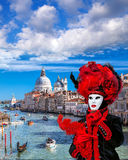 Carnival mask against Grand Canal in Venice, Italy Stock Image