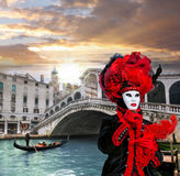 Carnival mask against Rialto bridge in Venice, Italy Royalty Free Stock Images