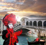 Carnival mask against Rialto bridge in Venice, Italy Stock Photos