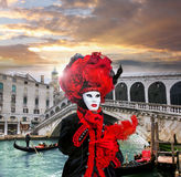 Carnival mask against Rialto bridge in Venice, Italy Stock Image