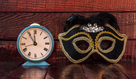 Carnival mask and alarm clock Stock Photo