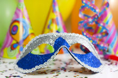 Carnival mask  background. Happy new  year background with carnival mask serpentines confetti and balloons Royalty Free Stock Images