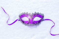 Carnival mask on a background of snow. Carnival mask on a background of snow art design stock photos