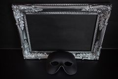 Carnival mask and beautiful silver frame baguette with empty place for your text or design. Carnival mask and beautiful silver frame with empty place for your Royalty Free Stock Photography