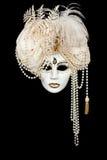 Carnival mask on black backround. White handmade venetian mask on black backround Stock Image