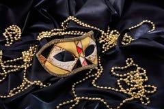 Carnival mask on black satin background Royalty Free Stock Photography