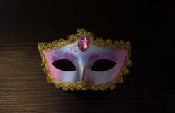 Carnival mask on black wooden background Stock Images