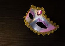 Carnival mask on black wooden background Royalty Free Stock Photo
