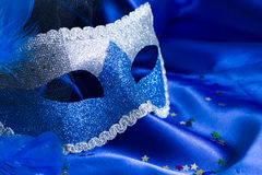 Carnival mask on blue background Royalty Free Stock Photo
