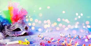 Carnival Mask With Blurred Streamer, Party Confetti royalty free stock photos