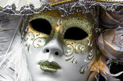 Carnival mask. Close up photo of a white golden venetian carnival mask Stock Photos