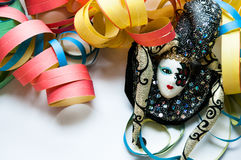 Carnival mask and colored streamers Royalty Free Stock Images