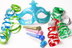 Carnival mask with colorful streamers and party horns Royalty Free Stock Photo