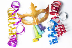 Carnival mask with colorful streamers and party horns Stock Photos
