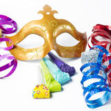 Carnival mask with colorful streamers and party horns Royalty Free Stock Image