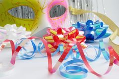 Carnival mask and decorative bows Stock Images