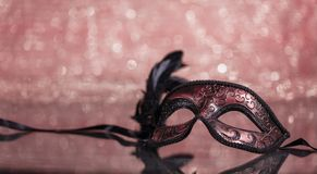 Carnival mask with feathers on bokeh background stock photography