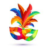 Carnival mask with feathers with colorful triangles pattern Royalty Free Stock Images