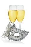 Carnival mask and glasses with champagne isolated Royalty Free Stock Photography