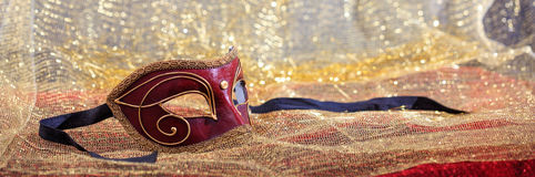Carnival mask on golden blur background Royalty Free Stock Photos