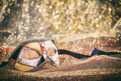 Carnival mask on golden blur background Stock Photography