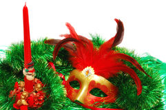 Carnival mask on a green New Year& x27;s ornament Stock Photo