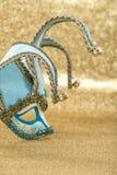 Carnival mask harlequin golden background venetian festival. Carnival mask harlequin on golden background. Symbol of venetian mask festival. Selective focus stock photos
