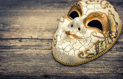 Carnival mask harlequin. Holidays background. Vintage toned Royalty Free Stock Photo
