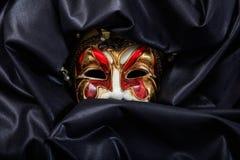 Carnival mask isolated on black satin background Royalty Free Stock Photo