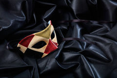 Carnival mask isolated on black satin background Royalty Free Stock Images
