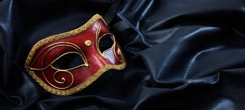 Carnival mask  on black satin background royalty free stock photos