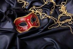 Carnival mask isolated on black satin background Royalty Free Stock Image
