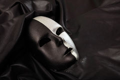 Carnival mask isolated on black satin background Stock Images
