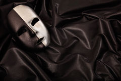 Carnival mask isolated on black satin background Royalty Free Stock Photography