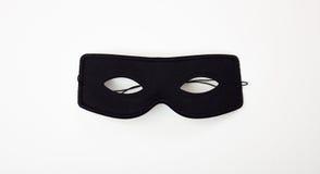Carnival mask isolated on white background. Black carnival mask isolated on white background Stock Photo