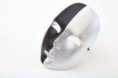 Carnival mask isolated on white background. Black and silver carnival mask isolated on white background Stock Photo