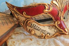 Carnival mask and a mandolin Royalty Free Stock Images
