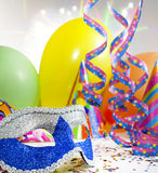 Carnival mask masquerade background. Happy new  year background with carnival mask serpentines confetti and balloons Stock Photos