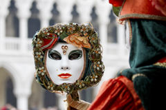 Carnival mask in a mirror Venice Italy Stock Image