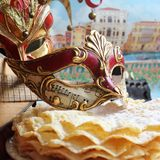 Carnival mask. With music notes somme pancakes and Venice in background and a mandolin Stock Photo