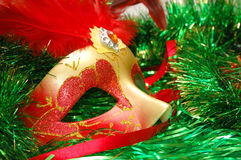 Carnival mask on a New Year's ornament. Carnival mask on a green New Year's ornament royalty free stock photography