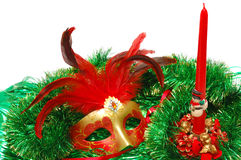 Carnival mask on a New Year's ornament. Carnival mask on a green New Year's ornament on white stock photos