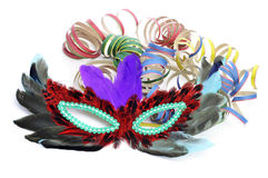 Carnival mask and paper streamers Stock Photos