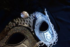 Carnival mask. Part of a black and silver mask on a black background royalty free stock photography
