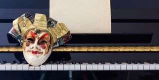 Carnival mask on piano keyboard, front view Stock Image